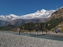 Damaged bridge, Marsyangdi River and Dhaulagiri, Lower Mustang Nepal Royalty Free Stock Photo