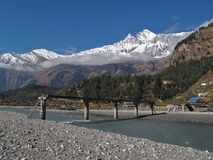Damaged bridge, Marsyangdi River and Dhaulagiri, Lower Mustang Nepal. Scenery in the Annapurna Conservation Area, Nepal stock images