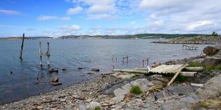 Damaged bridge on sea coast Stock Images