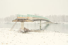 Damaged Bridge in the Snow Royalty Free Stock Photography