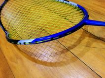 Damaged, broken badminton racket. A close up photograph showing a badminton racket which has been damaged and broke during play due to impact collision with stock photo