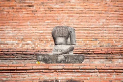 Damaged Buddha statue in the grounds of Wat Mahathat, Ayutthaya, Thailand Stock Images