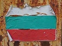 Damaged Bulgarian flag on rusty metal sheet. Royalty Free Stock Image