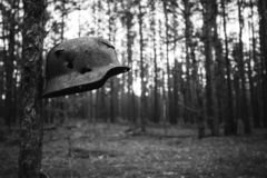 Damaged By Bullets And Shrapnel Metal Helmet Of German Infantry royalty free stock images