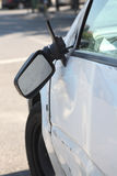 Damaged car and broken side rear view mirror. Stock Photography