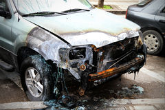 Damaged car, after fire. Close up of a damaged car, after fire Royalty Free Stock Photography