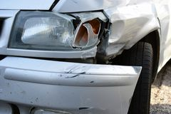 Damaged car. Front view of damaged silver car after accident Royalty Free Stock Images