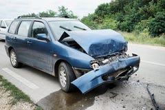Damaged car on road Stock Photo