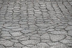 Damaged car road with a lot of cracks Royalty Free Stock Image