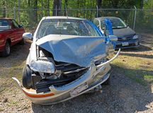 Damaged car in scrap yard Royalty Free Stock Photo