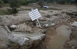 Damaged cars and debris after floodings in San Llorenc in the island Mallorca vertical stock photo