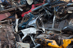 Damaged cars in recycling junkyard. Used damaged cars backdrop abstract background texture Stock Photos