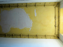 Damaged ceiling in an old abandoned home Stock Photography
