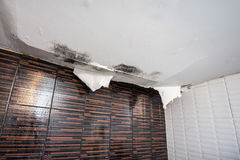 Damaged ceiling. From water leak stock images