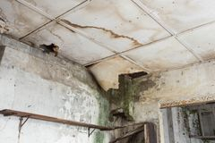 Damaged ceiling from water leak in old abandoned house royalty free stock image
