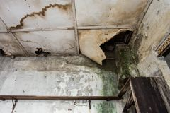 Damaged ceiling from water leak in old abandoned house stock images