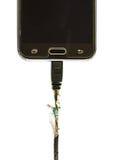 Damaged Charging of mobile phone on white background. Royalty Free Stock Image