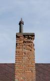 Damaged chimney. Old - rustic and damaged brick chimney Royalty Free Stock Photography
