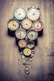 Damaged clocks in pile. Closeup of damaged clocks in pile Royalty Free Stock Images