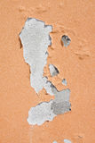 Damaged colored plaster - concept image useful image also to express the concepts of: aging, decadence, aging of human skin and so Royalty Free Stock Photos