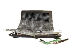 Damaged computer broken into parts Stock Images