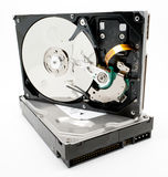 Damaged computer hard drive. A damaged computer hard drive on top of a working drive - the importnace of backing up Royalty Free Stock Images