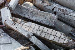 Damaged concrete blocks, piles and pipes Stock Images