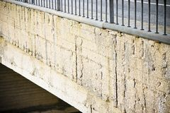Damaged concrete. Caused by rusting reinforcement bars royalty free stock photos