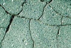 Damaged cyan toned asphalt texture Royalty Free Stock Photos