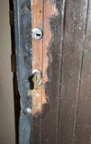 Damaged door after housebreaking. Damaged door and lock after housebreaking, close-up Stock Photography