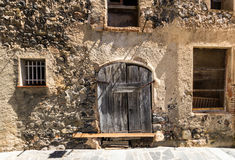 Damaged door in the old town. Of Castellfollit, Spain stock images