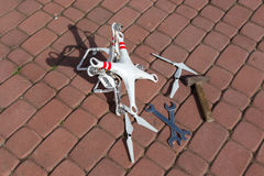Damaged drone. Small damaged drone after the bad accident Stock Image