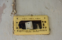 Damaged electrical switch. Stock Photography