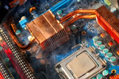 Damaged electronic pc component. As background Stock Image