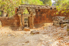 Damaged entrance to Ta Prohm temple, Angkor Thom, Siem Reap, Cambodia. Royalty Free Stock Photos