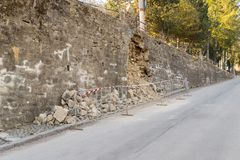 Damaged exterior reinforcement wall - danger on the road royalty free stock photo