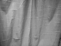 Damaged fabric. Old courtain gray Royalty Free Stock Photography