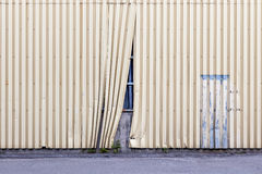 Damaged fence, behind which hides the unfinished object Royalty Free Stock Photo