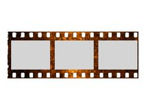 Damaged film strip. Old grunge film strip... perfect to place your images into it Royalty Free Stock Images