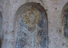 Damaged Fresco in La Chiesa Di Lama D` Antico, Parco Rupestre Lama D`Antico. Pictured is a badly damaged fresco in an ancient cave church, La Chiesa Di Lama D` Stock Photo