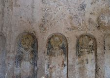 Damaged Frescos in La Chiesa Di Lama D` Antico, Parco Rupestre Lama D`Antico. Pictured are badly damaged frescos in an ancient cave church, La Chiesa Di Lama D` Royalty Free Stock Images