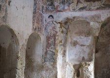Damaged Frescos in La Chiesa Di Lama D` Antico, Parco Rupestre Lama D`Antico. Pictured are badly damaged frescos in an ancient cave church, La Chiesa Di Lama D` Stock Photo