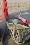 Damaged, full wheelbarrow. Stock Photo