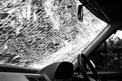 Damaged glass (car windshield) inside car Royalty Free Stock Images