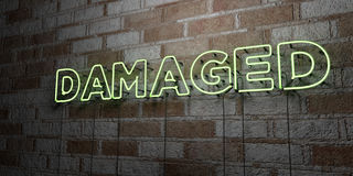 DAMAGED - Glowing Neon Sign on stonework wall - 3D rendered royalty free stock illustration. Can be used for online banner ads and direct mailers Royalty Free Stock Photo