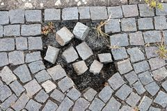 Damaged granite walkway Stock Images
