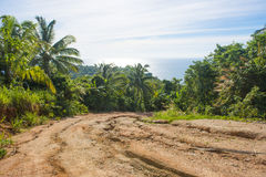 Damaged of gravel road in a rural area Royalty Free Stock Images