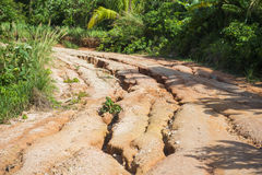 Damaged of gravel road in a rural area Stock Photo