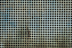 Damaged grunge metallic square-meshed panel texture Stock Photography