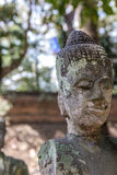 Damaged handless buddhist statue. A damaged buddhist sculpture with no hand Royalty Free Stock Image